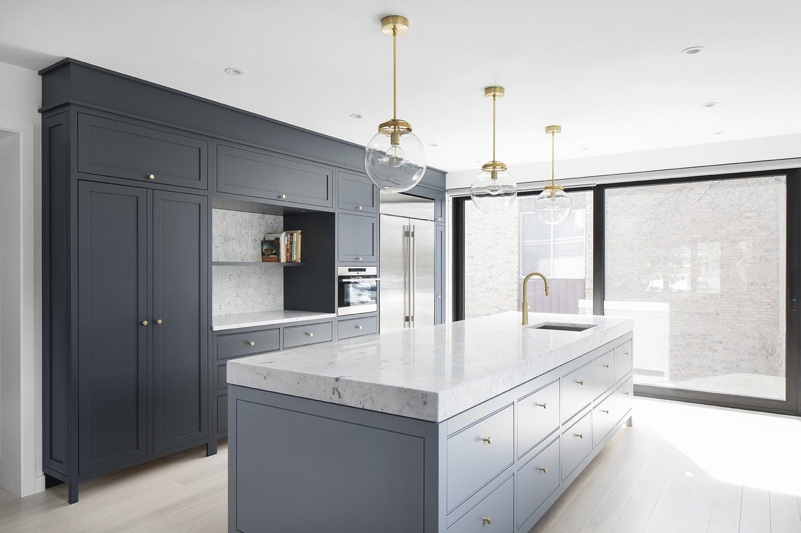 Kitchen, Refrigerator, Marble Counter, Wall Oven, Pendant Lighting, Recessed Lighting, Light Hardwood Floor, Undermount Sink, Colorful Cabinet, and Stone Slab Backsplashe  Hampstead House by RobitailleCurtis