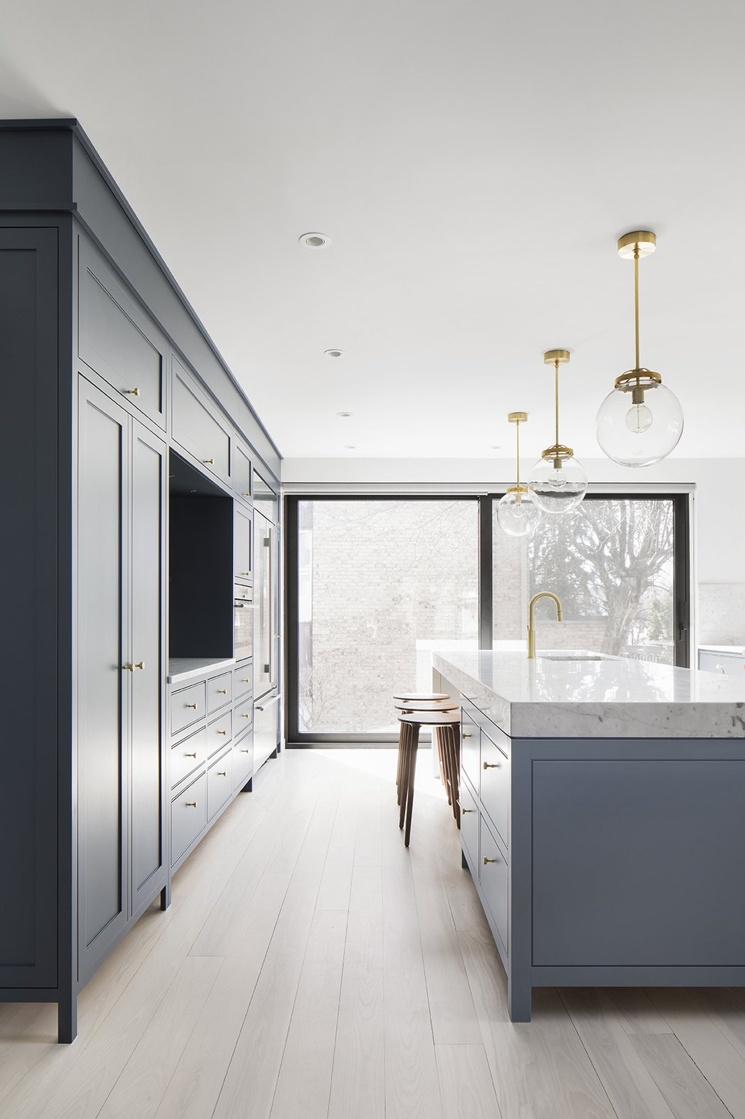 Kitchen, Recessed Lighting, Colorful Cabinet, Pendant Lighting, Refrigerator, Light Hardwood Floor, Marble Counter, Wall Oven, and Undermount Sink  Hampstead House by RobitailleCurtis