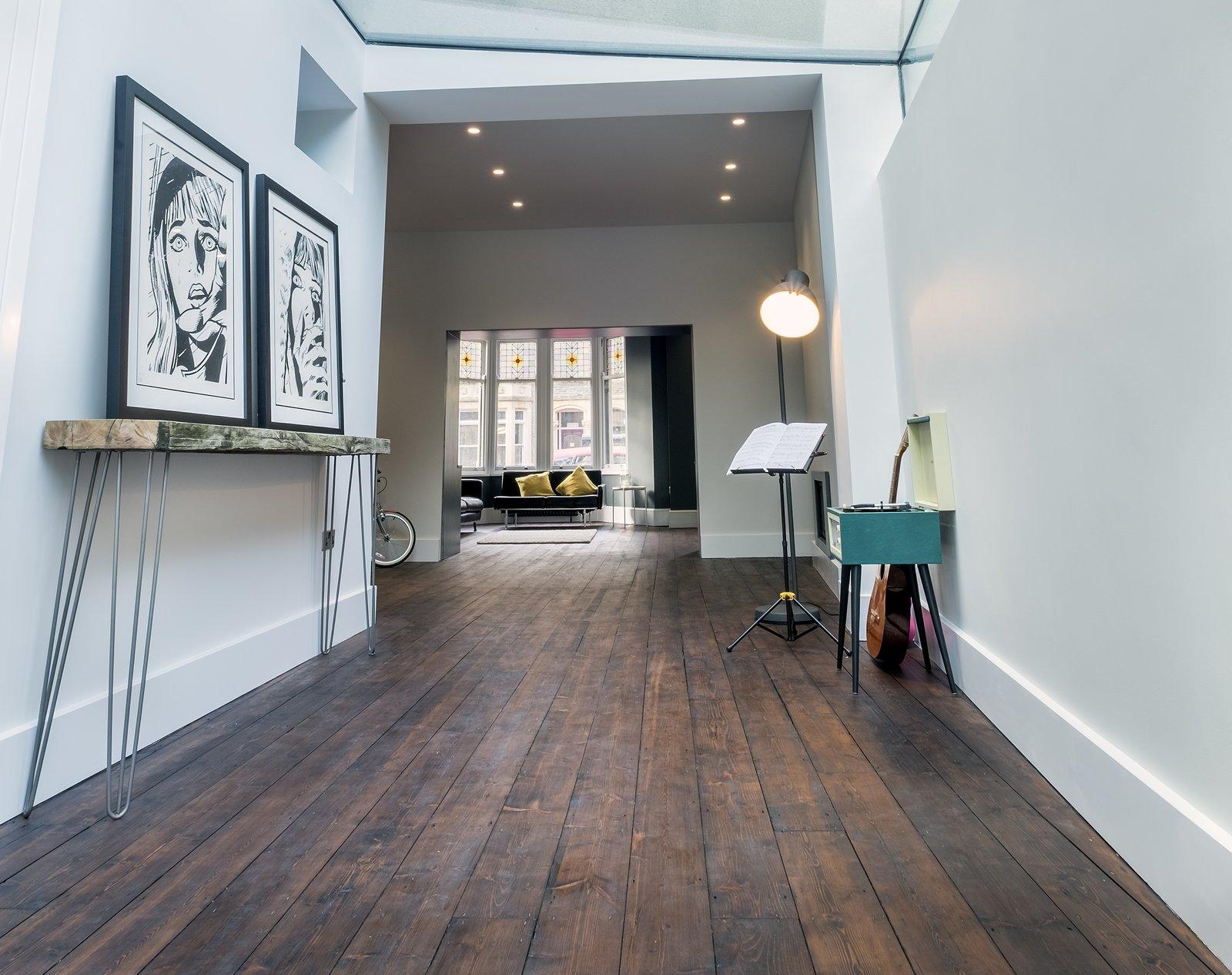 Living Room, Dark Hardwood Floor, Console Tables, Ceiling Lighting, Sofa, and Floor Lighting  THE GLASSHOUSE