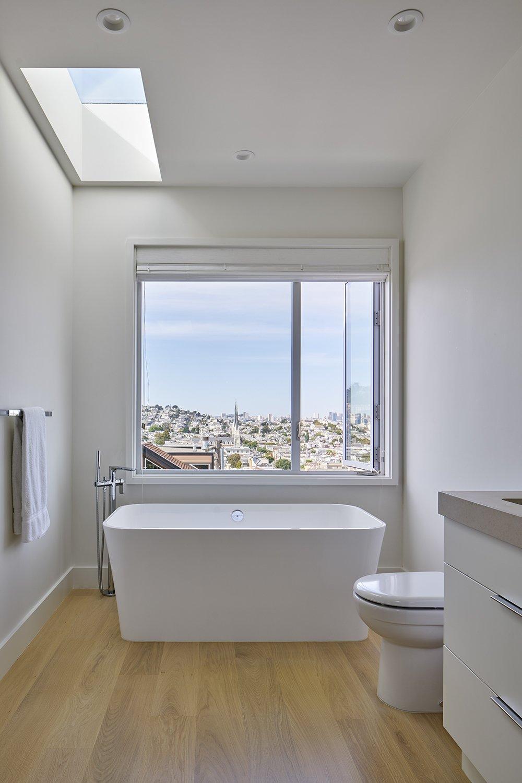 Bath Room, Light Hardwood Floor, and Freestanding Tub  Photos from Randall Street