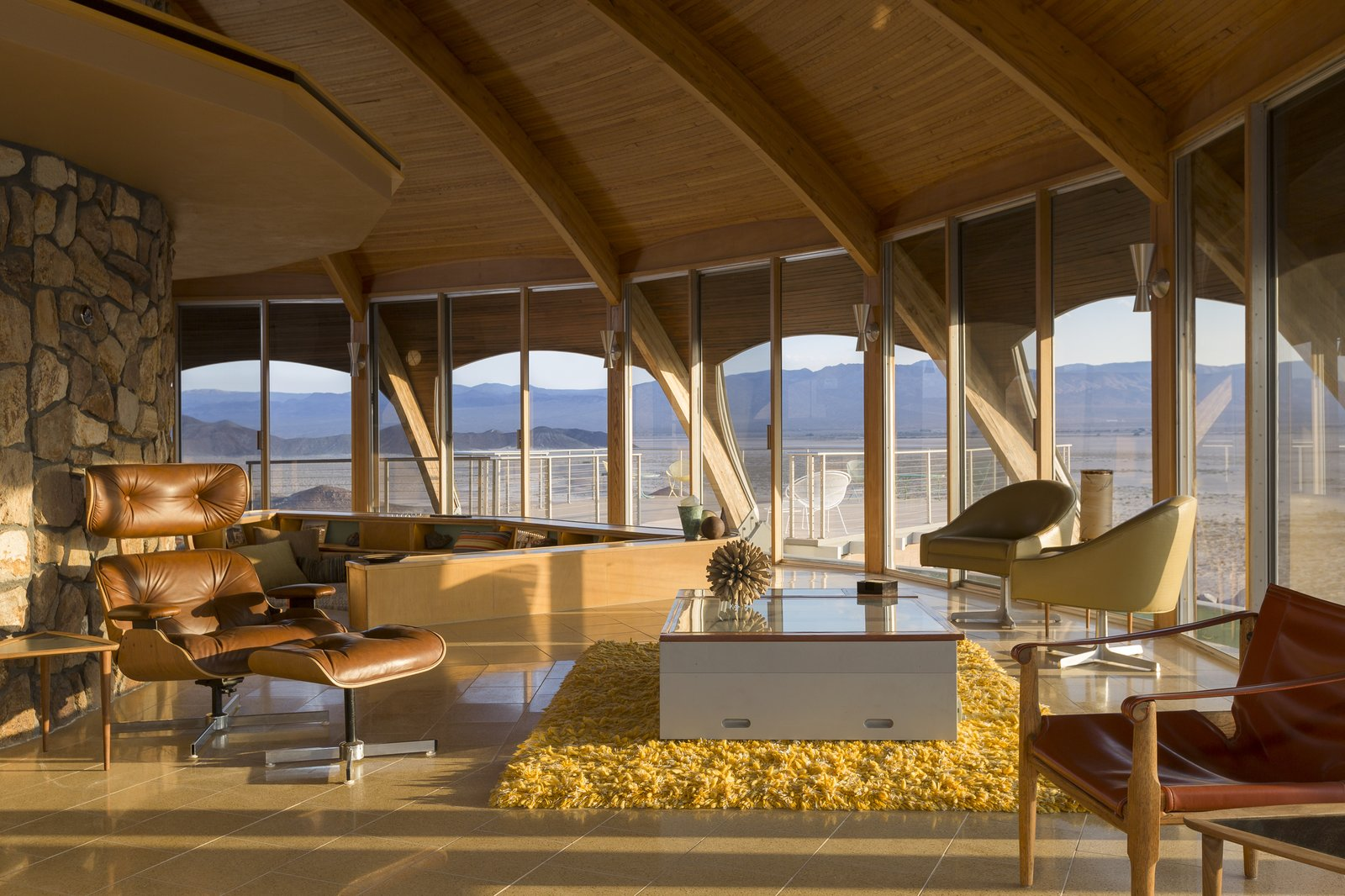 Tagged: Living Room, Chair, Coffee Tables, Wall Lighting, and Ceramic Tile Floor.  Volcano House by lance gerber