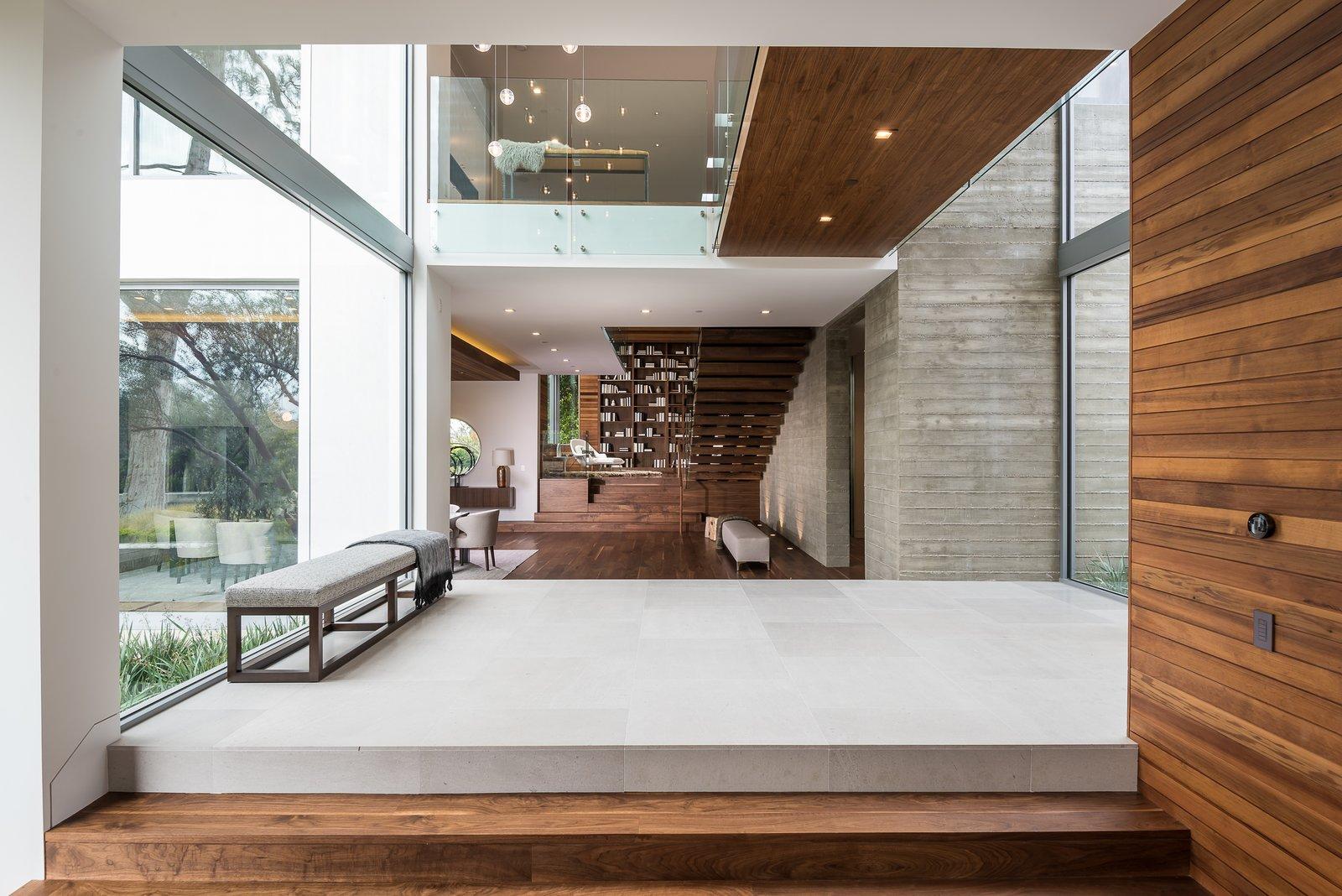 Living Room, Bench, Pendant Lighting, Dark Hardwood Floor, and Ceiling Lighting  Ravoli Drive Residence