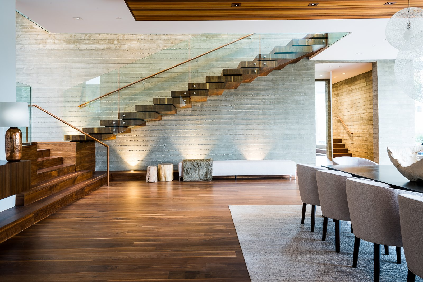 Dining Room, Chair, Dark Hardwood Floor, Table, Bench, Recessed Lighting, and Ceiling Lighting  Ravoli Drive Residence