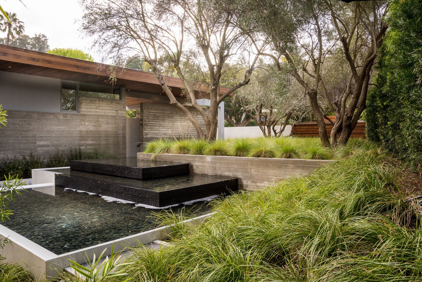 Outdoor, Landscape Lighting, Grass, Concrete Fences, Wall, Hardscapes, Horizontal Fences, Wall, Trees, Shrubs, Wood Fences, Wall, and Front Yard  Ravoli Drive Residence