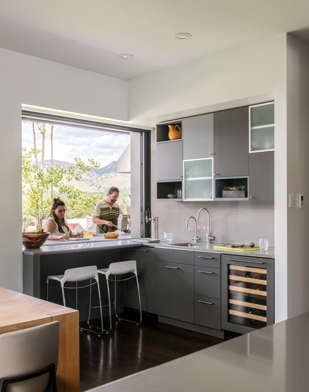 A Pocket Window In The Kitchen Allows For Double Sided Bar Area With