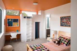 This second- floor children's bedroom is made for fun: A jungle gym on the far wall includes a curtained-off play space, and kids can climb by ladder up to a little bed where friends can gather or sleep over. (It is removable, so the room can be made into a more grown-up space in future years.) Using the animal artwork over the bed as inspiration, Goff added a playful giraffe table lamp from Alex Marshall Studio, IKEA Odestrad bedding, and Oeuf Sparrow Nightstands from All Modern.