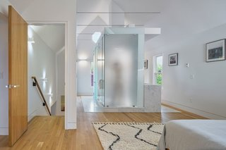 The reinvention of the bathroom as a sculptural element in the master suite creates a unique focal point while maximizing the transmission of light into the space. Rather than treat the bathroom as a utilitarian object, Arch11 facilitates an elevated bathing experience in which each dedicated space provides a sense of purpose and reflection.