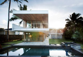 "The house's L-shaped form creates a dialogue in which the yard becomes an integral, outdoor room for the home. Designed with walls and windows that ""disappear"" when opened, the architectural elements reinforce the Hawaiian lifestyle in which lines are consistently blurred between the time spent indoors and outdoors."