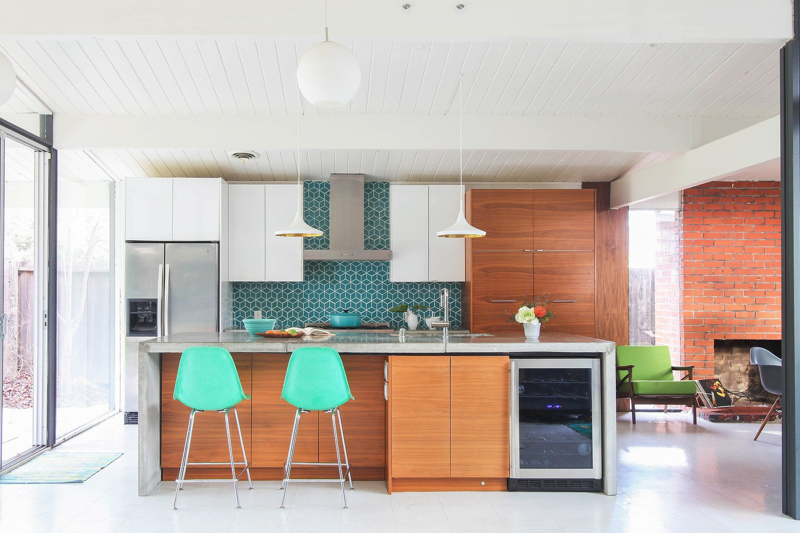 Kitchen, Ceramic Tile, Refrigerator, White, Undermount, Wood, Wine Cooler, Vinyl, Concrete, Range Hood, and Pendant  Kitchen Vinyl White Range Hood Photos from Walnut Creek Eichler Renovation
