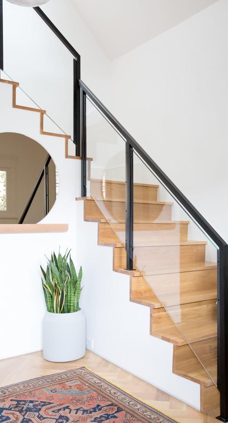 Staircase, Wood Tread, Glass Railing, and Metal Railing    Noe Valley Parisian Atelier by Regan Baker Design