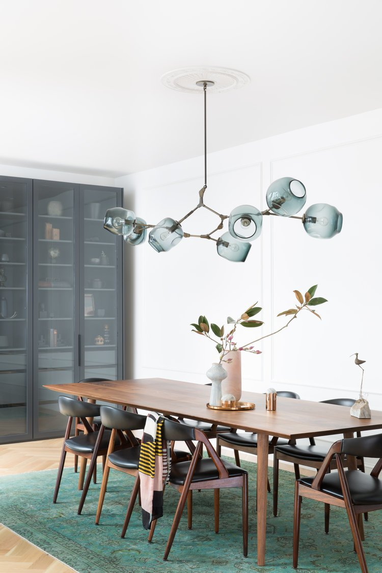 Dining Room, Ceiling Lighting, Storage, Table, Lamps, Chair, and Light Hardwood Floor    Noe Valley Parisian Atelier by Regan Baker Design