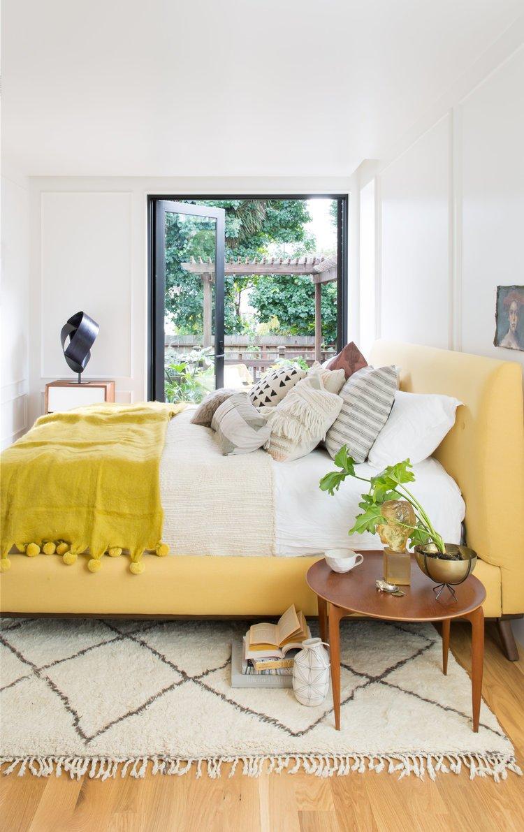 Bedroom, Night Stands, Storage, Light Hardwood Floor, and Bed    Noe Valley Parisian Atelier by Regan Baker Design