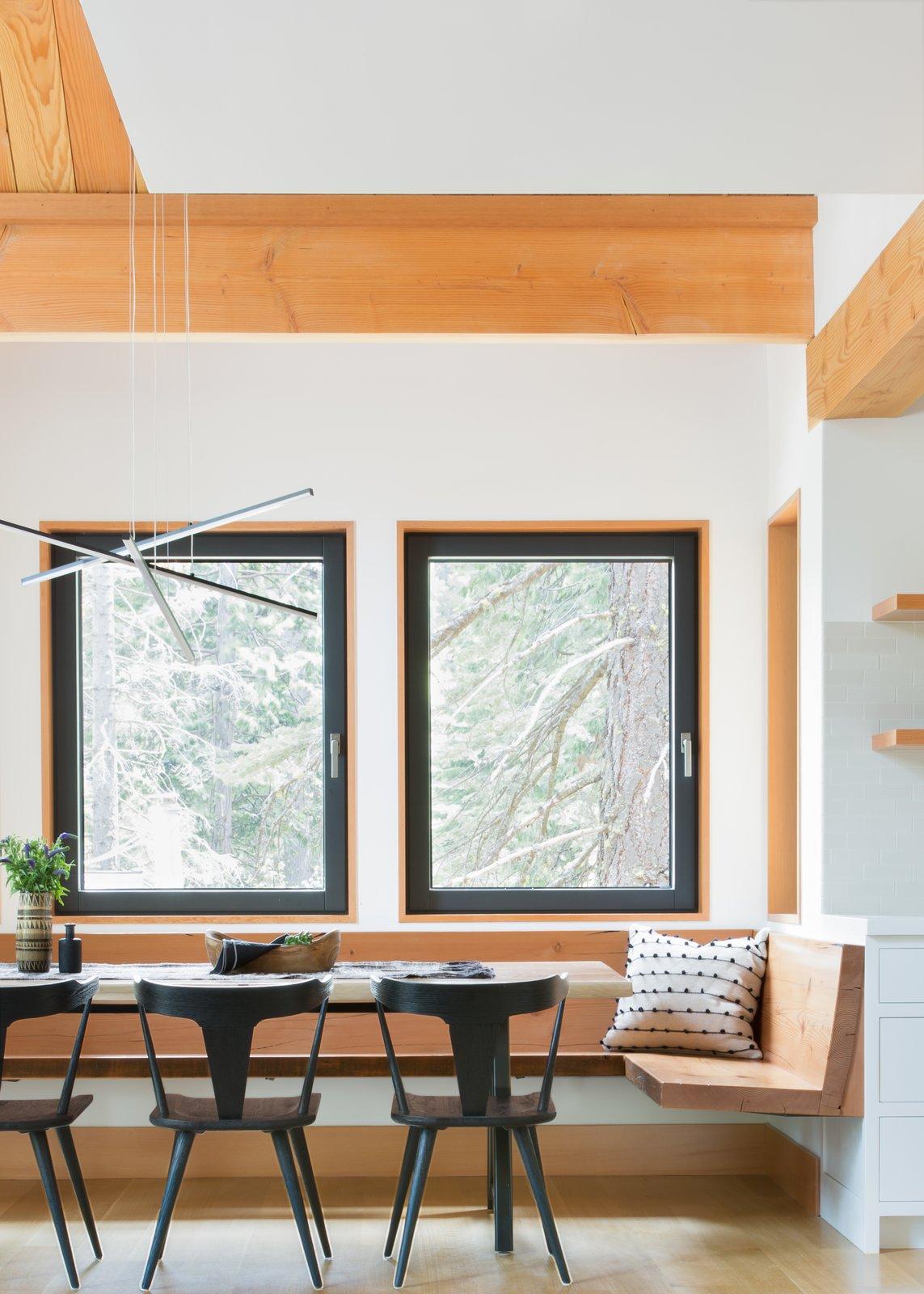 Dining Room, Bench, Chair, Pendant Lighting, Table, Light Hardwood Floor, and Ceiling Lighting  Woodsy Tahoe Cabin by Regan Baker Design