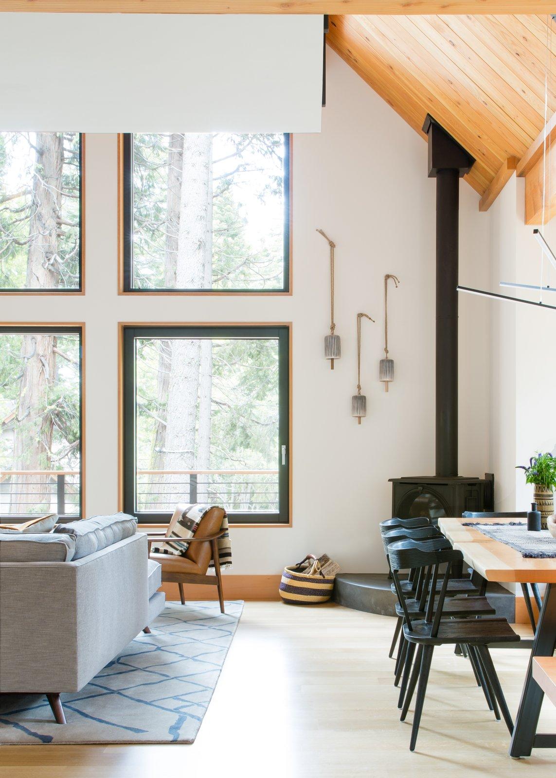 Living Room, Sectional, Corner Fireplace, and Medium Hardwood Floor  Woodsy Tahoe Cabin by Regan Baker Design