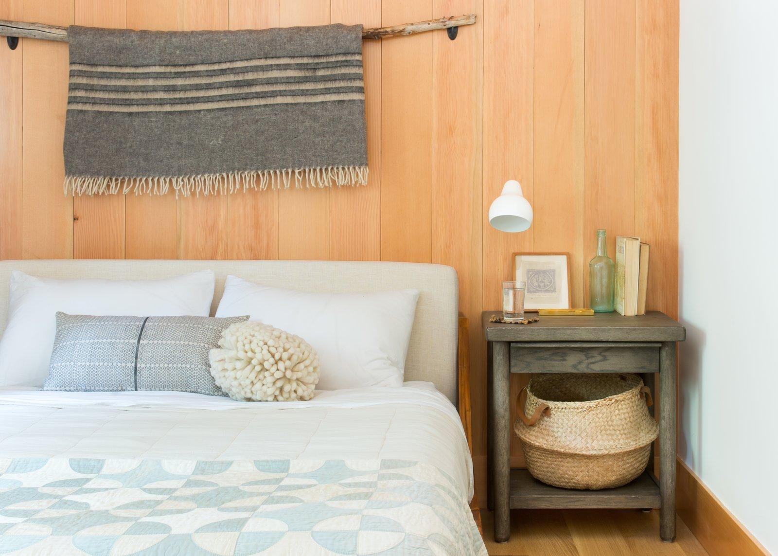 Bedroom, Night Stands, Bed, Light Hardwood Floor, and Wall Lighting  Woodsy Tahoe Cabin by Regan Baker Design