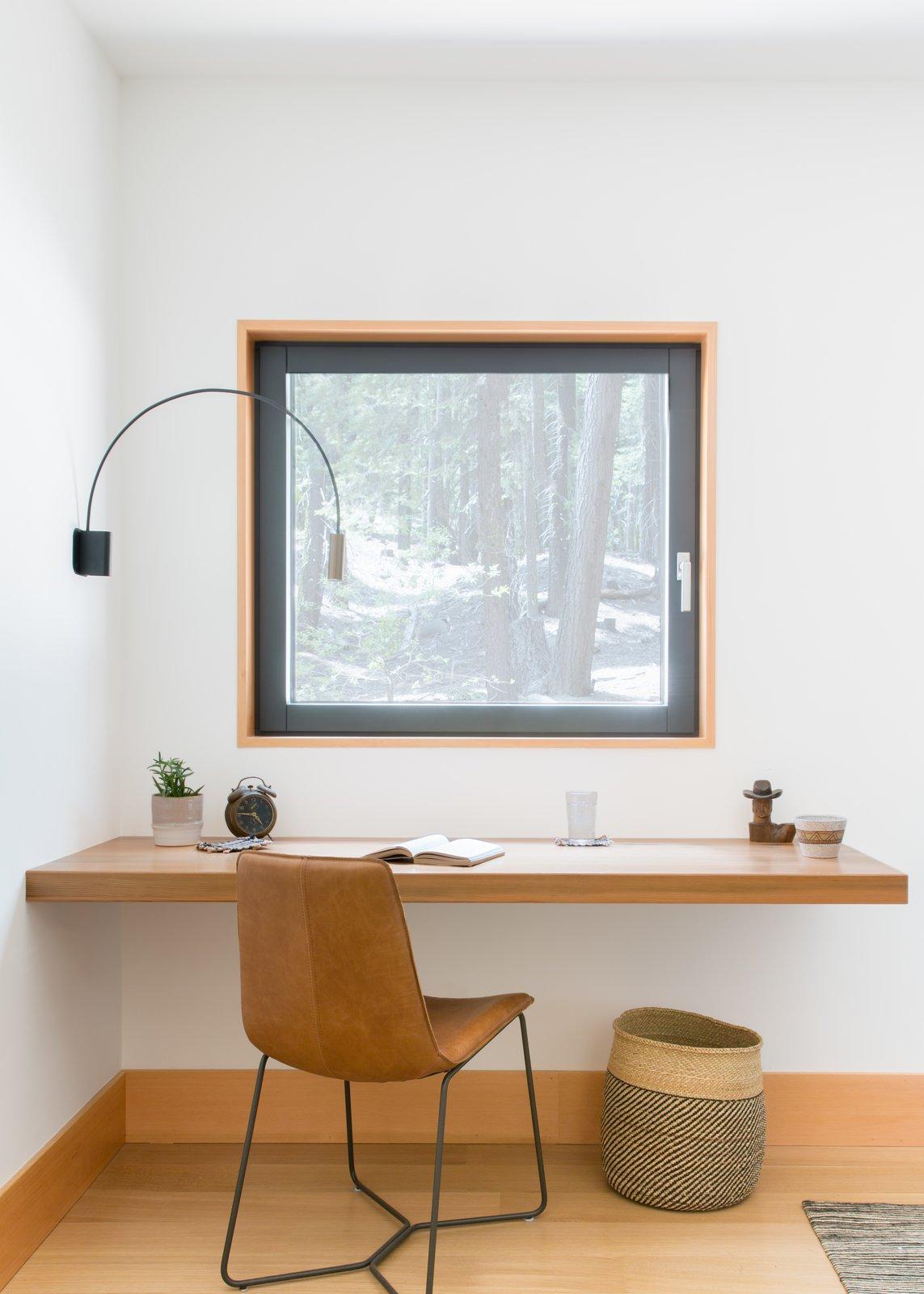 Office, Lamps, Light Hardwood Floor, Desk, and Chair  Woodsy Tahoe Cabin by Regan Baker Design