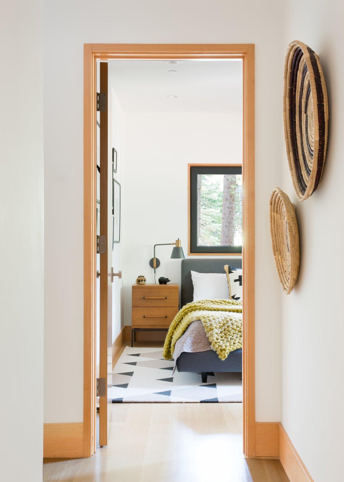 Bedroom, Night Stands, Bed, and Light Hardwood Floor  Woodsy Tahoe Cabin by Regan Baker Design
