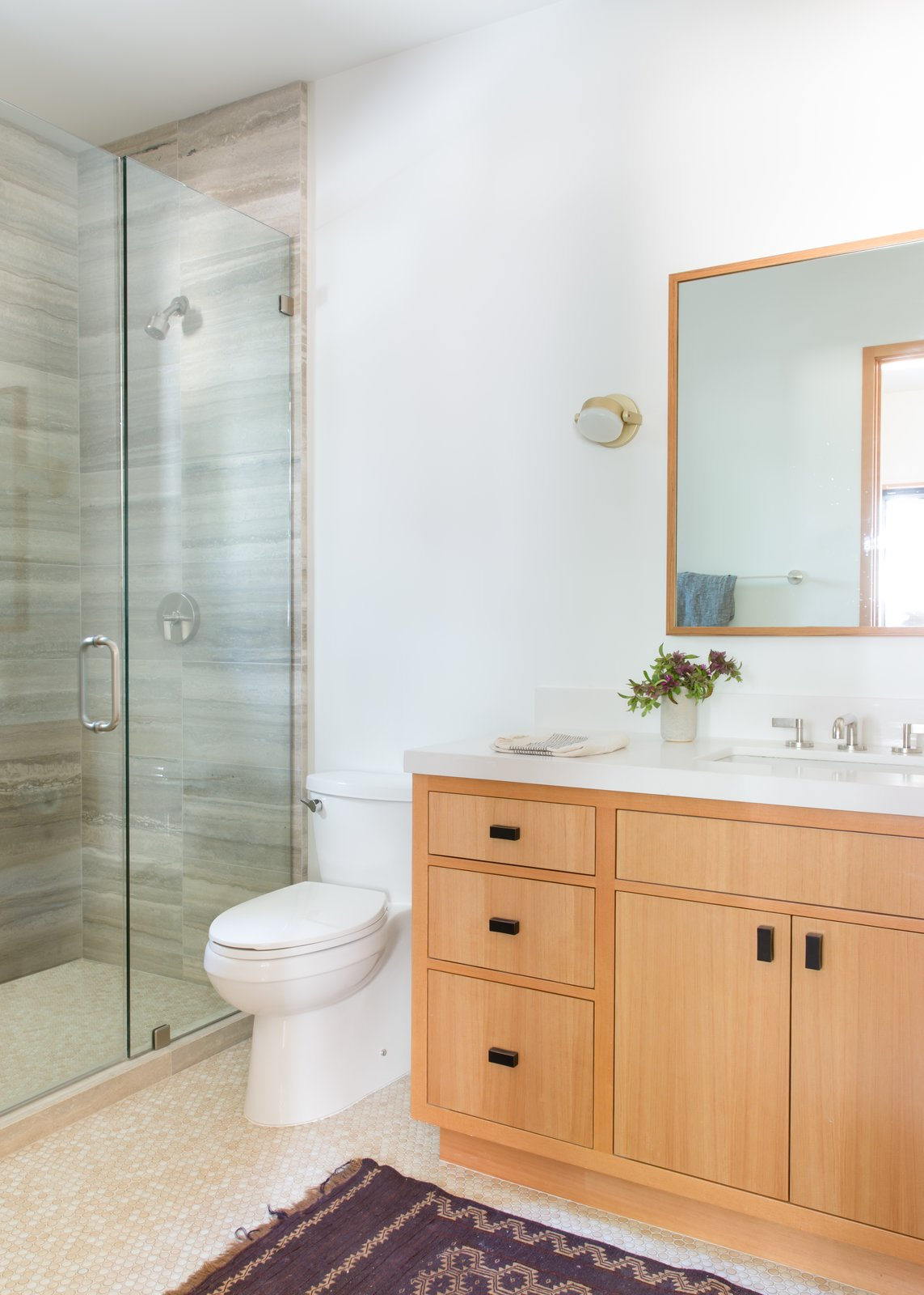 Bath Room, Ceramic Tile Floor, Wall Lighting, Enclosed Shower, One Piece Toilet, Wood Counter, and Undermount Sink  Woodsy Tahoe Cabin by Regan Baker Design