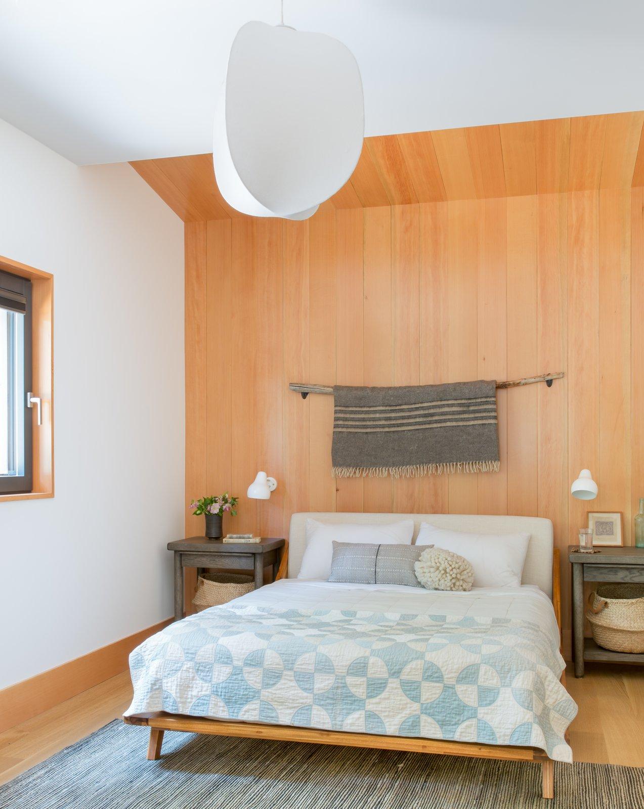 Bedroom, Bed, Light Hardwood Floor, Wall Lighting, Night Stands, Ceiling Lighting, and Rug Floor  Woodsy Tahoe Cabin by Regan Baker Design
