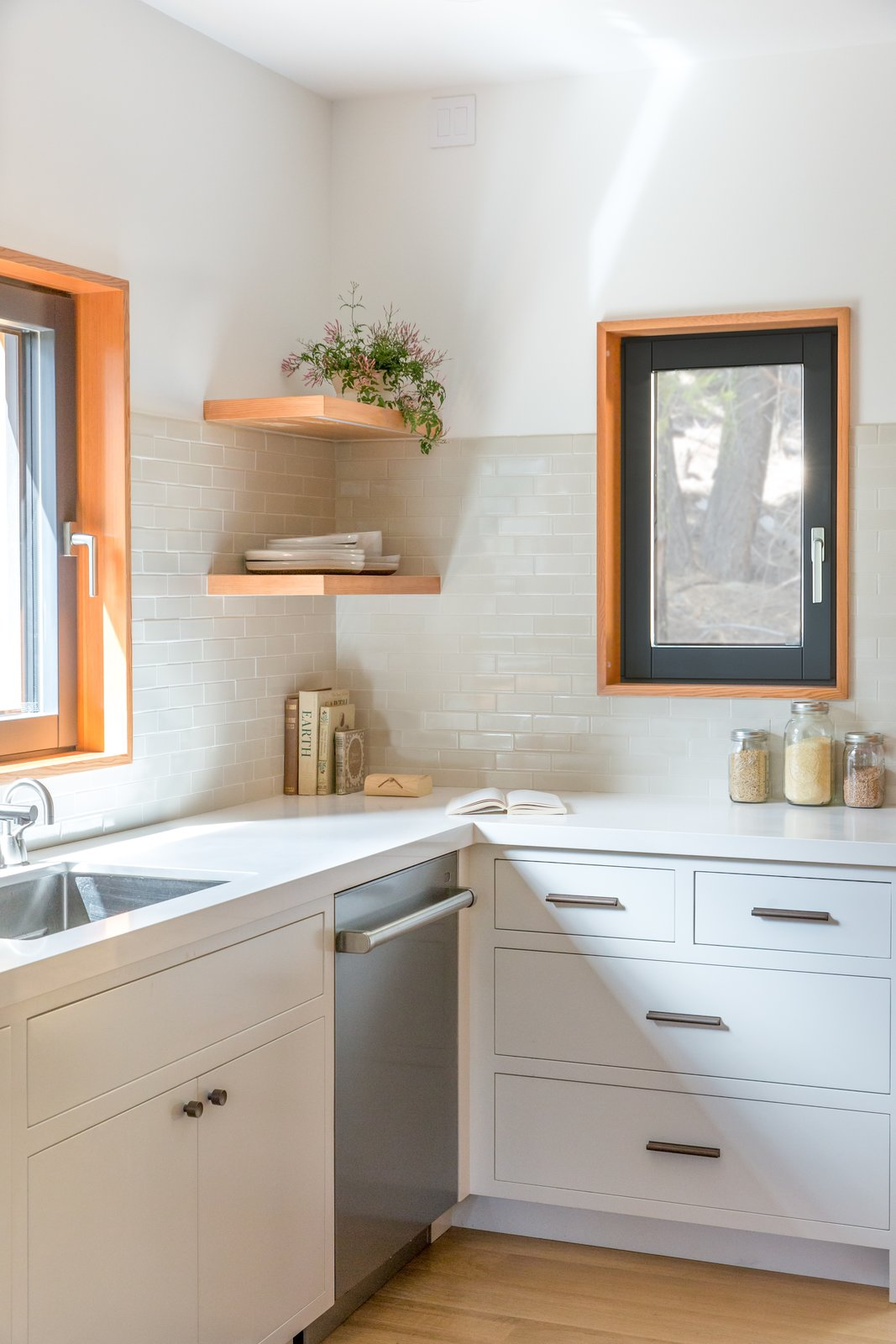 Kitchen, White Cabinet, Ceramic Tile Backsplashe, Light Hardwood Floor, and Undermount Sink  Woodsy Tahoe Cabin by Regan Baker Design