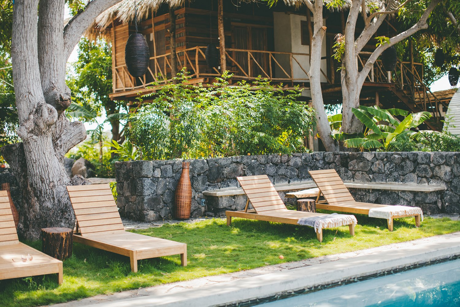 Outdoor, Small Pools, Tubs, Shower, Grass, Trees, and Stone Fences, Wall The property features many such traditional craft elements native to Nicaragua; rancho builders from the La Paz Centro region of Nicaragua, architects and engineers from Granada, and craftspeople from all over the country helped build the property, creating everything from light fixtures to stone sinks. Andrew and Kristin enlisted landscape expertise from Chris Shanks, a permaculture educator based in Ometepe, who helped educate the duo on practical plants to grow for teas and edible consumption. Accessory designs like white bed linens with colorful throws are a work of Daina Platais of local shop Amano.  Photo 8 of 12 in Isleta El Espino: A Three-Room Eco Hotel on Lake Nicaragua