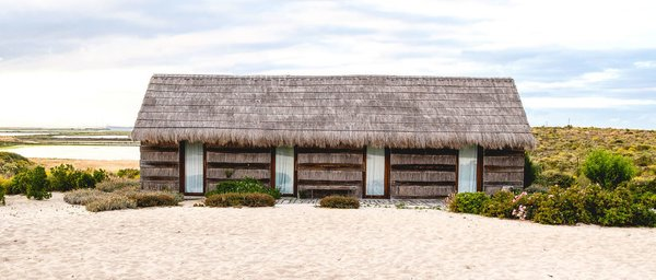 Portugal's Thatched-Roof Beach Cabins Bring the Outdoors In