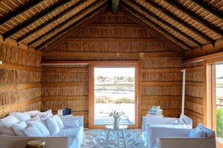 Portugal's Thatched-Roof Beach Cabins Bring the Outdoors In - Photo 4 of 5 -