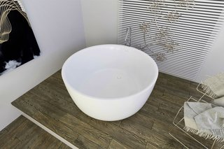 "PureScape 720 is a minimalistic, freestanding, bowl-shaped tub, which has been hand crafted in Italy using Aquatica's technologically advanced AquateX™ solid surface material. Its soft, velvety surface juxtaposes the material's unparalleled heat retention and durability. With a petite footprint of 53.25"" in diameter, PureScape 720 is considerately designed for even the most compact of spaces."