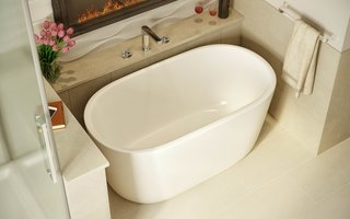 "Lullaby Nano is Aquatica's take on creating a small deep bathtub that is ideal for a space conscious bathroom while providing that much loved modern freestanding design. Standing at just over 51"" in length, this chic pill-shaped tub has an extra deep ergonomically designed interior to ensure you enjoy a full-body soak. Crafted from Aquatica's technologically advanced AquateX™ solid surface material, Lullaby Nano offers a velvety soft matte surface and superior heat-retention and durability."