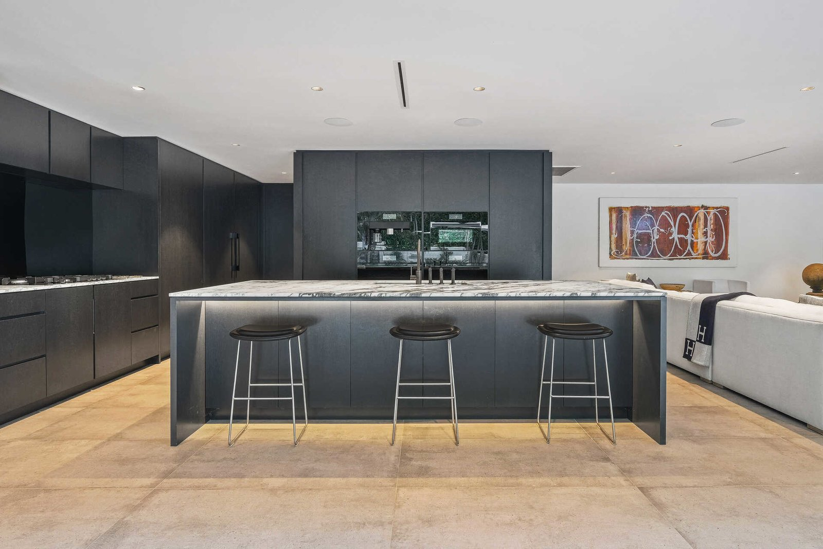 Kitchen, Stone Counter, Recessed Lighting, Wood Cabinet, Cement Tile Floor, and Concrete Floor  A Midcentury Modern Oasis in Bel Air