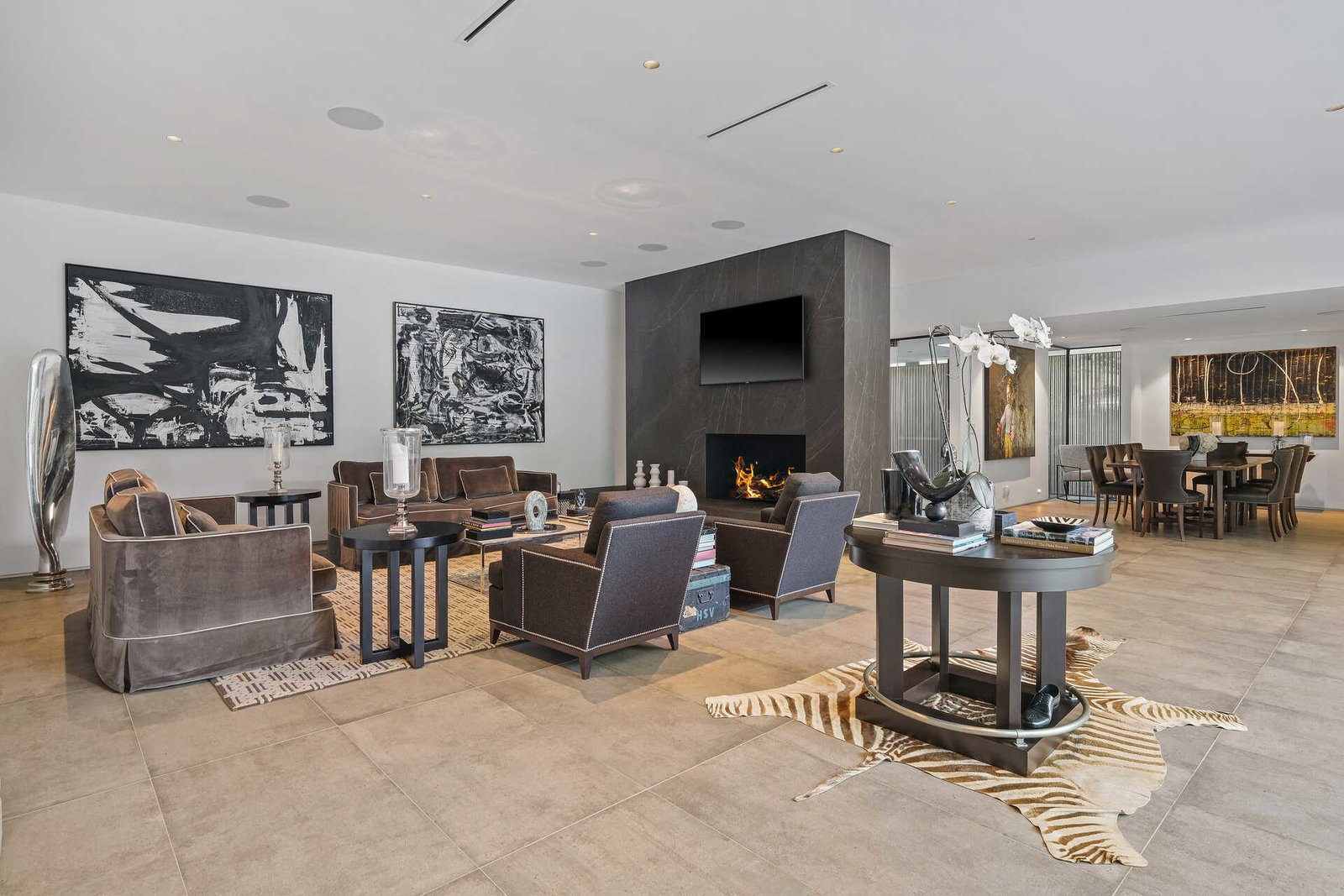 Living Room, Standard Layout Fireplace, Table, Chair, End Tables, Sofa, Cement Tile Floor, and Recessed Lighting  A Midcentury Modern Oasis in Bel Air