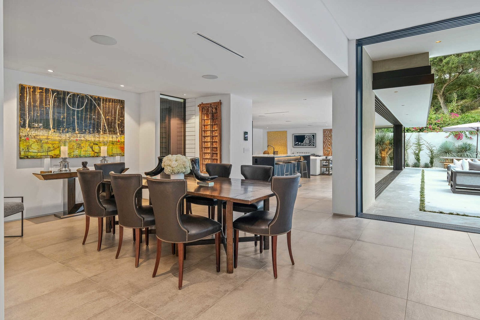 Living Room, Chair, Table, Concrete Floor, Cement Tile Floor, and Recessed Lighting  A Midcentury Modern Oasis in Bel Air