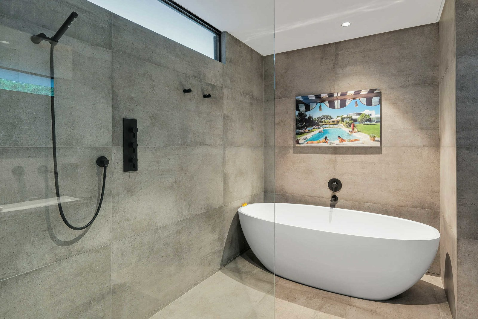 Bath Room, Stone Tile Wall, Soaking Tub, Concrete Floor, Recessed Lighting, Enclosed Shower, Freestanding Tub, and Concrete Wall  A Midcentury Modern Oasis in Bel Air