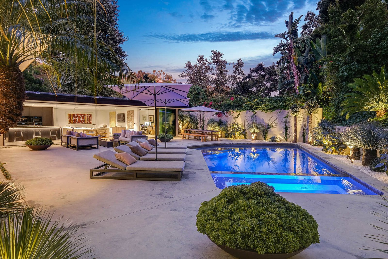 Outdoor, Stone Patio, Porch, Deck, Back Yard, Large Patio, Porch, Deck, Landscape Lighting, Shrubs, Large Pools, Tubs, Shower, Trees, and Concrete Patio, Porch, Deck  A Midcentury Modern Oasis in Bel Air