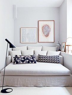 Pairing patterned throw pillows with a neutral sofa creates a soothing palette in a tight space.