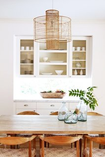 White walls and cabinetry + leafy greens + mid-century style chairs = simple, classic California style