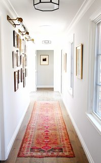 A beautiful and bold vintage runner adds color and pattern to create a dynamic hallway.