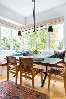 The very essence of California cool—black light fixture, leather chairs and a gorgeous vintage rug.