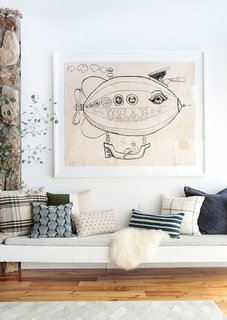 Quirky, oversized artwork paired with pretty pillows—always a win in our book.