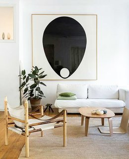 Graphic black and white artwork punctuates the bright, neutral space.
