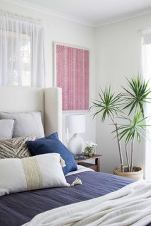 Layered throw pillows add color, texture and subtle pattern.