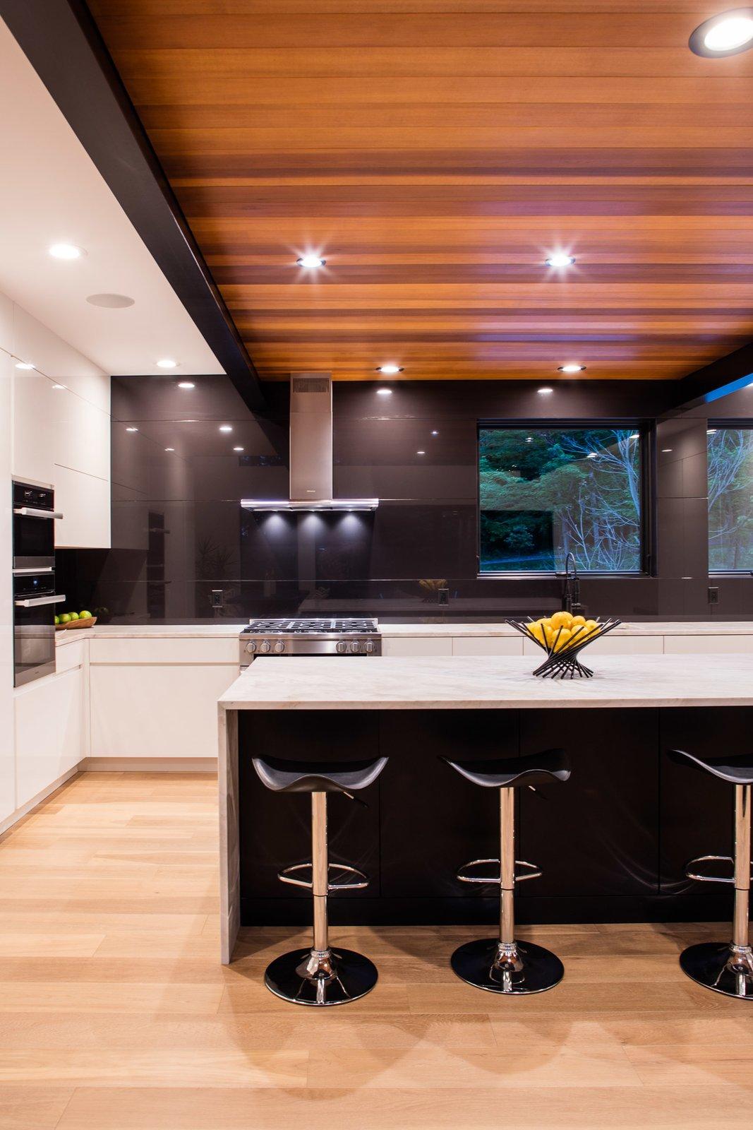Kitchen, Quartzite, Wall Oven, Light Hardwood, Undermount, Range, White, and Refrigerator  Best Kitchen Quartzite Range Undermount Photos from Rogue River Residence