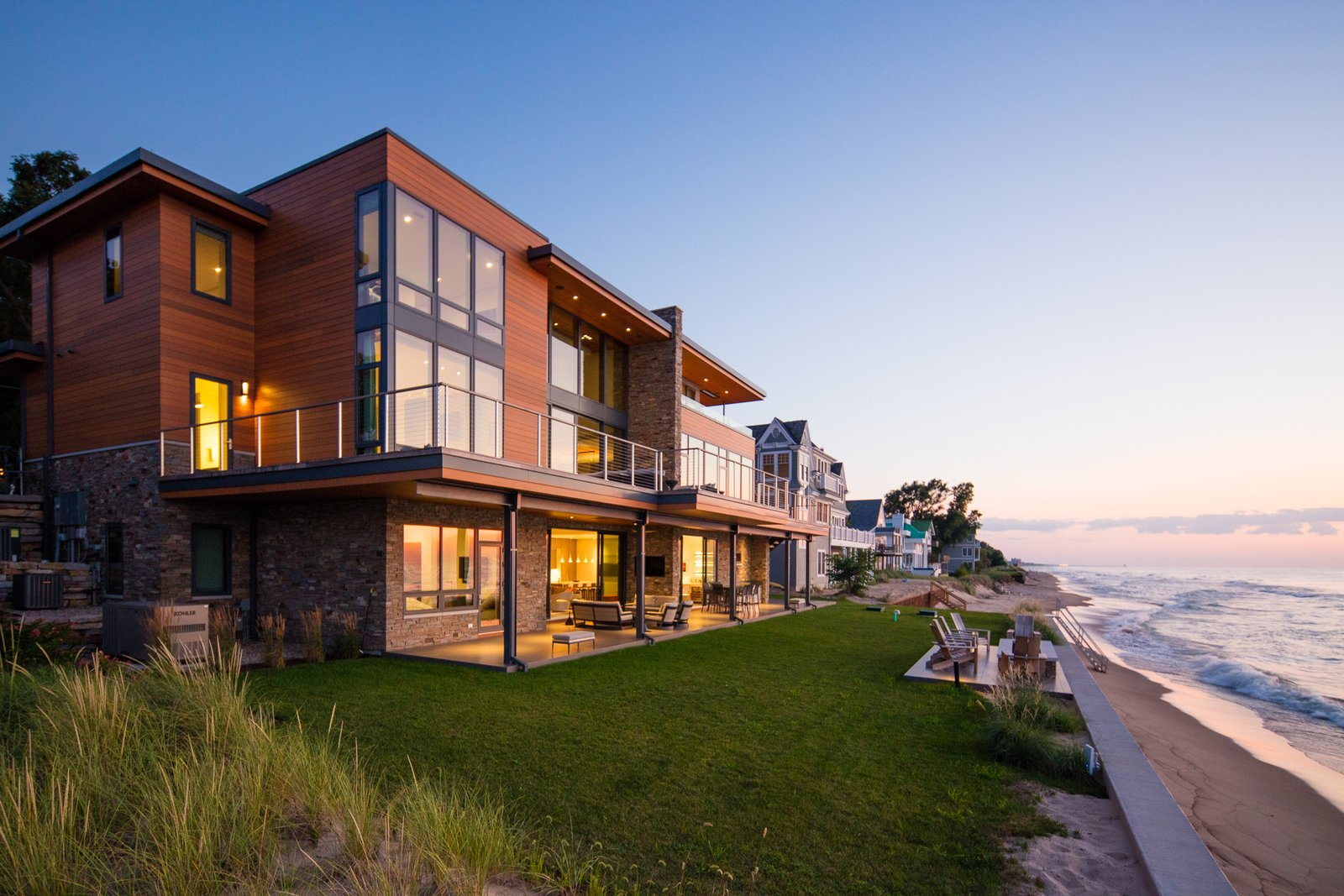 Exterior, Wood Siding Material, Stone Siding Material, House Building Type, Flat RoofLine, Beach House Building Type, and Metal Roof Material  Lucid Architecture's Favorites from Long Beach