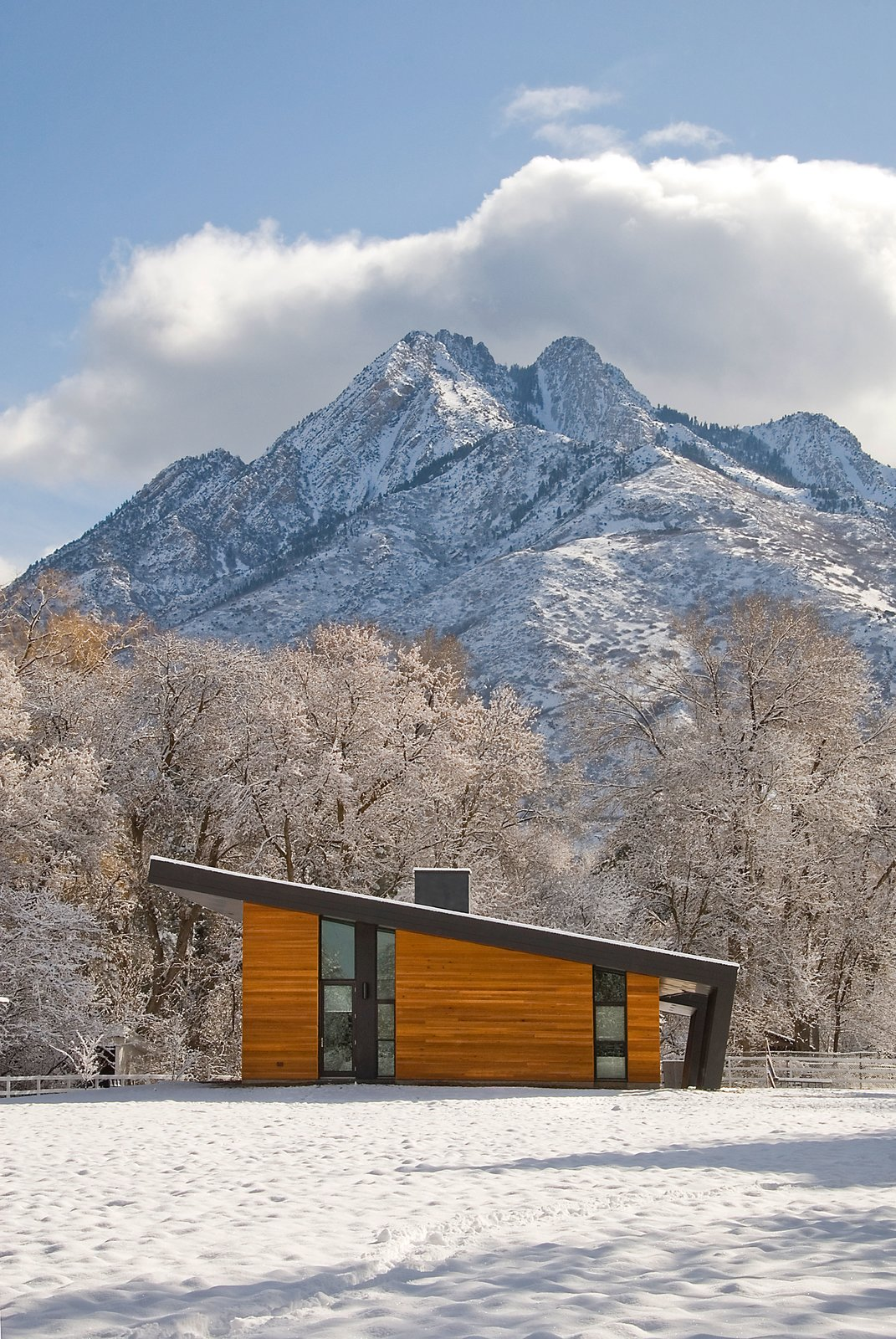 Exterior, House Building Type, Cabin Building Type, Wood Siding Material, and Shed RoofLine West Facade  Photo 9 of 10 in The Best-Shaped House For Every Climate in the U.S. and Tips For Optimizing Sustainability from Pasture Project