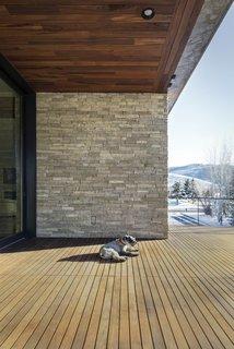 """""""The Lucky John home's lot is literally located just minutes from Park City's world class ski resorts in Utah.  In order to capture views of 'the greatest snow on earth' and the mountain slopes that contain it, the owners asked that the main level be situated on the upper level of the home's two stories."""" - Imbue Design"""