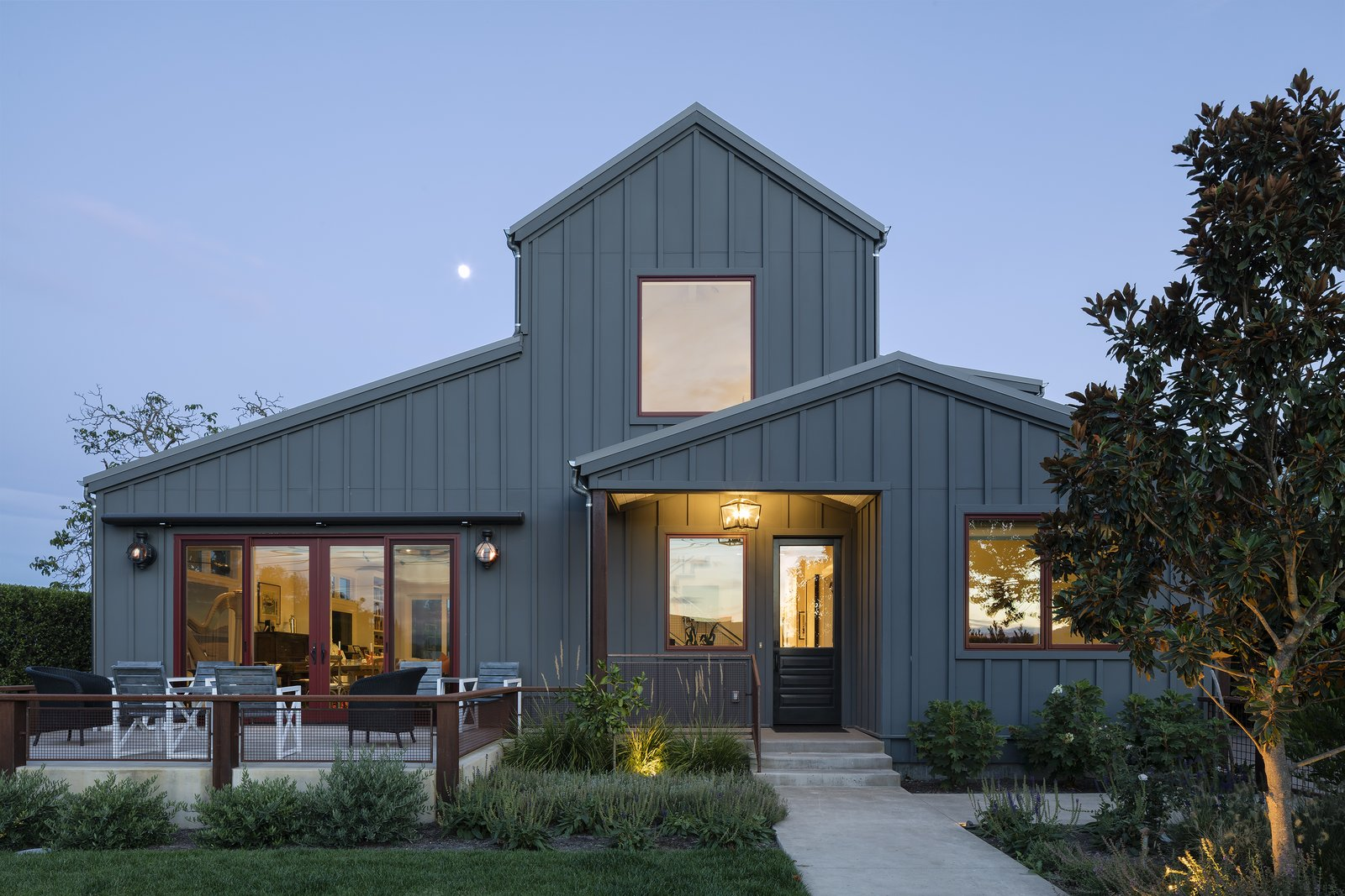 Exterior, Gable RoofLine, House Building Type, and Wood Siding Material This contemporary farmhouse was designed for a client that loves to cook and entertain in the open air.   Photo 5 of 20 in 20 Modern American Farmhouses That Update Tradition from Modern Farmhouse II