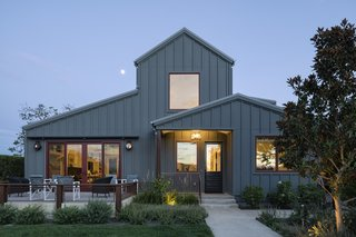 This contemporary farmhouse was designed for a client that loves to cook and entertain in the open air.