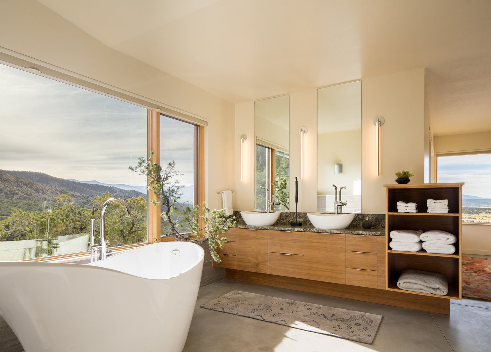 Bath Room, Freestanding Tub, Vessel Sink, Soaking Tub, Concrete Floor, and Wall Lighting  Photo 2 of 5 in Top 5 Homes of the Week With Blissful Bathrooms from Northern Slope Sanctuary