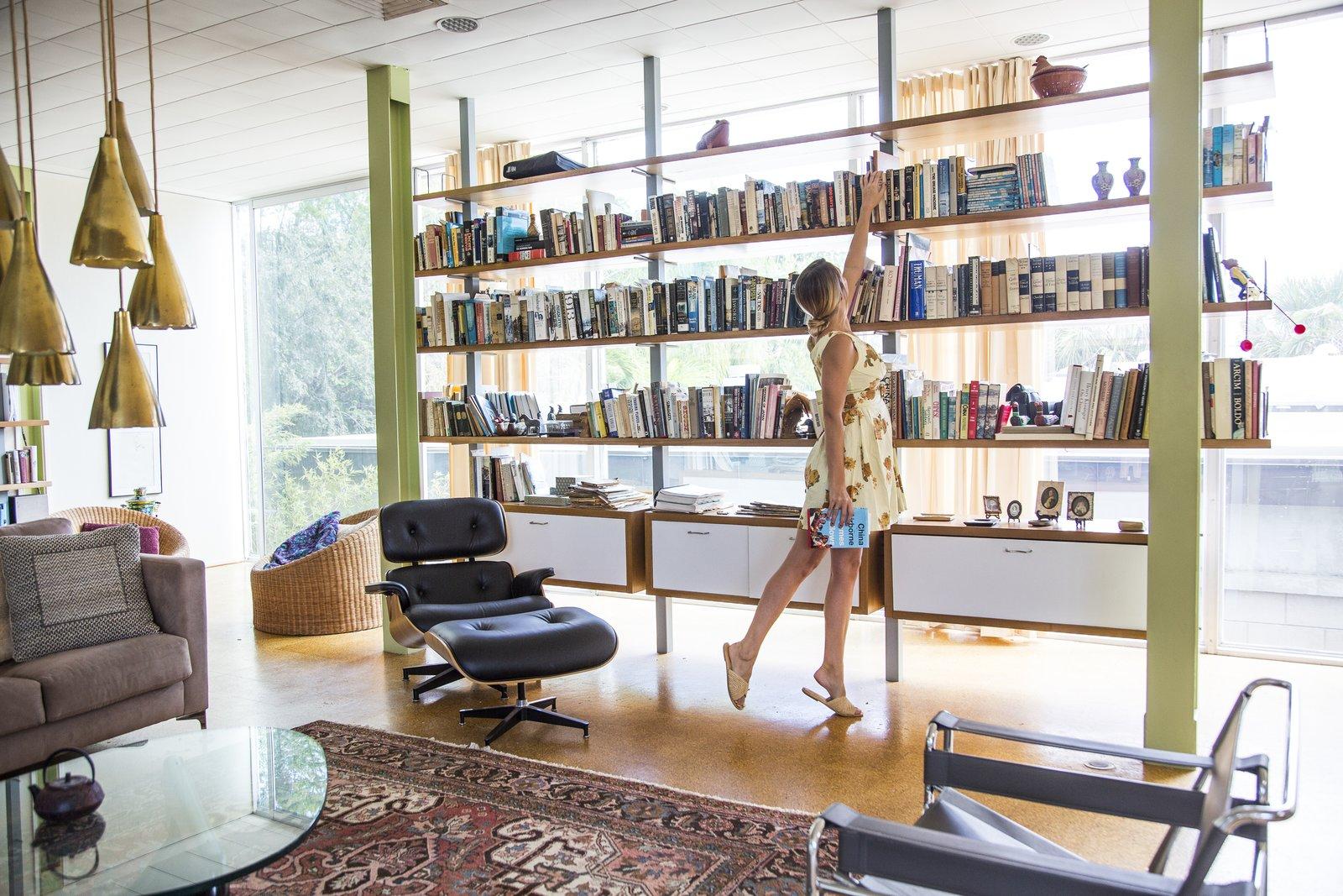 Living Room, Chair, Sofa, Ceiling Lighting, Pendant Lighting, Cork Floor, Bookcase, Rug Floor, and Coffee Tables  Hiss Studio