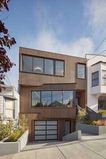 """The subtly angled facade design was created by adapting to  different setbacks of the neighboring houses, and as a  response to the downhill views to the east,"" says IwamotoScott Architecture. The facade of the Noe Valley House simultaneously stands out and blends in with its neighbors."